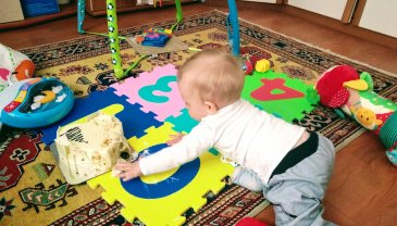 Activity report for 8 month old motor skills in Wachanga!