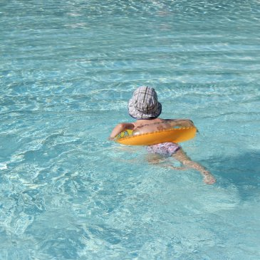 Go to an outdoor swimming pool with your kid