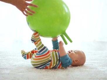 Play with a big inflatable ball