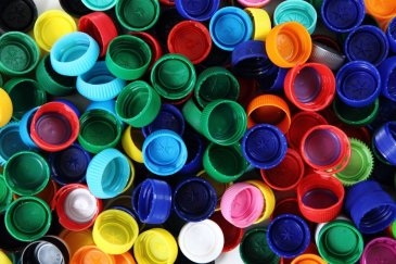 Playing with plastic bottle caps