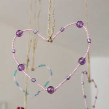 Make hearts out of beads with your kid
