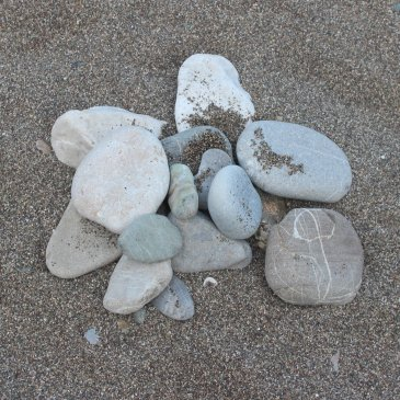 Play with the stones on a beach