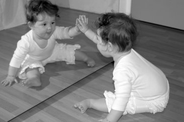 Offer your baby to play with a mirror!