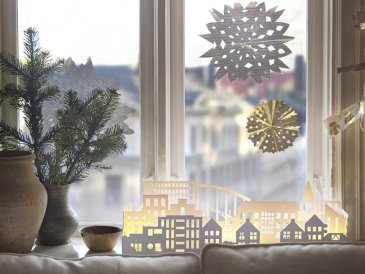 Decorate windows with snowflakes