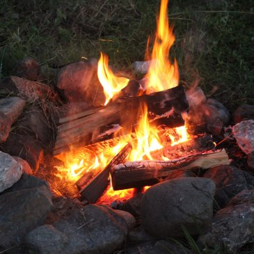 Sit around the campfire at night with your kid