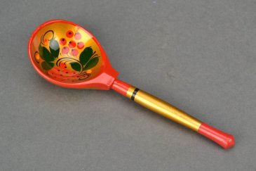Offer your baby to play with a wooden spoon