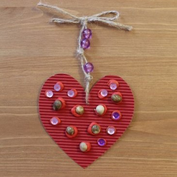 Make a Valentine Day Card out of colored cardboard and plasticine
