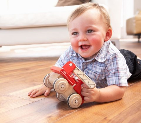 Roll a toy car with your baby