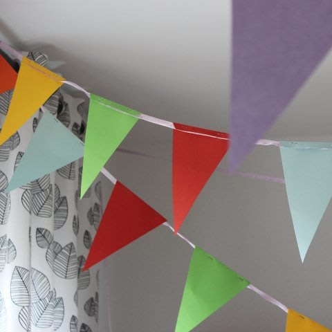 Make flags out of colored paper with your kid