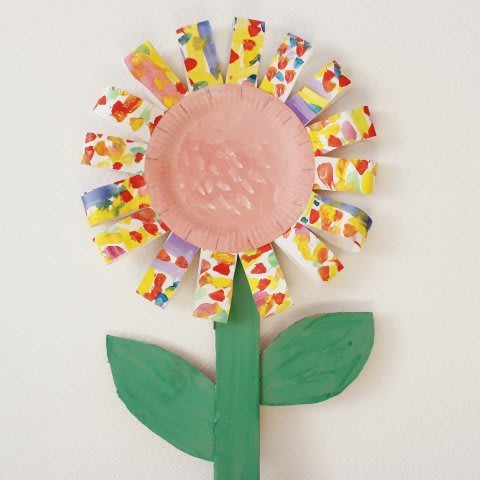 Make flowers out of disposable plates with your kid