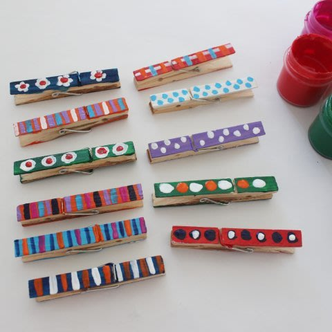 Decorate clothespins with your kid