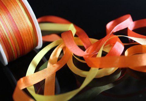 Offer your baby to play with a ribbon