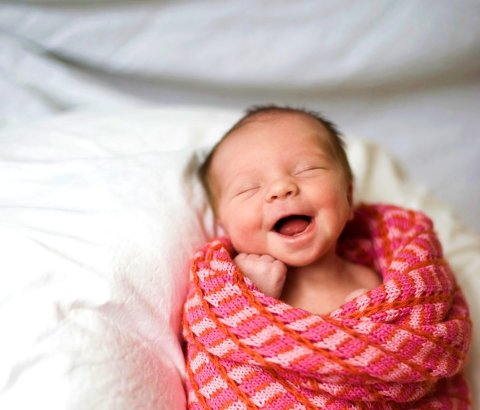 Make a photo of your baby's first smile!