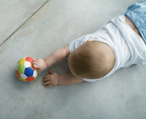 Teach your baby to play with a ball