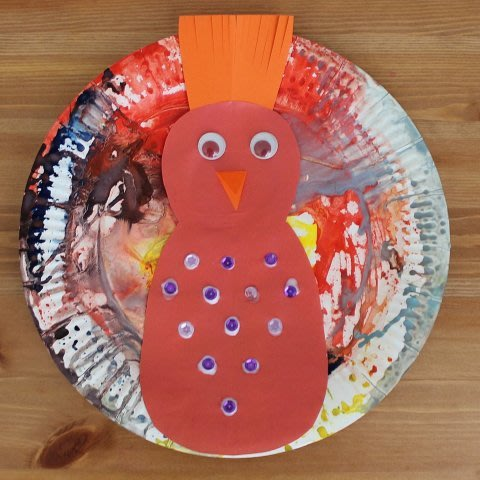 Peacock out of a disposable plate
