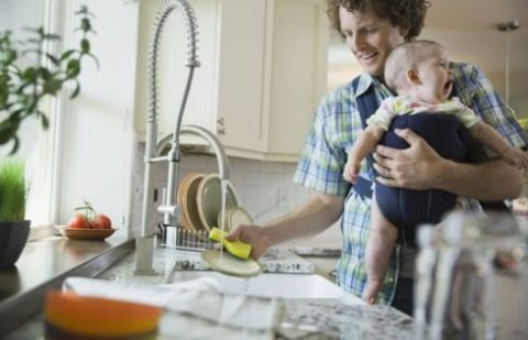 Wash the dishes holding your baby with one hand