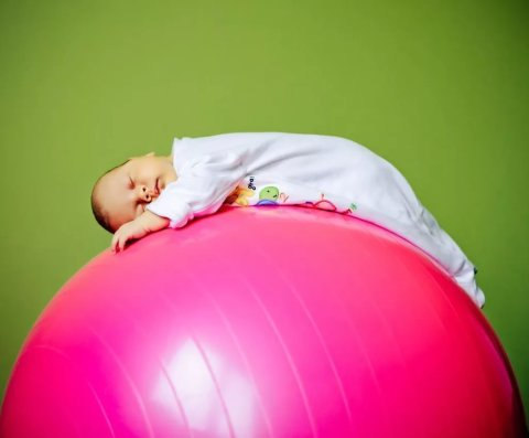 Start using a fitball for tummy time!