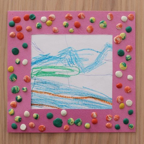 Make a photo frame out of paper and plasticine with your toddler