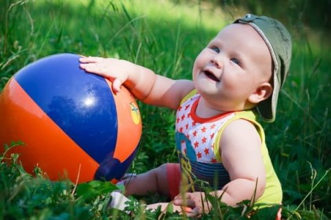 Offer your toddler to play with a big inflatable ball
