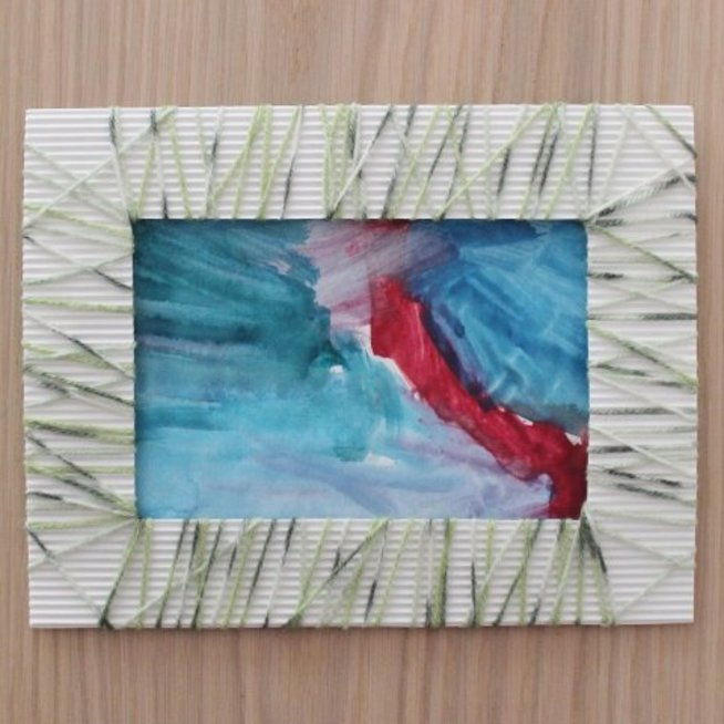 Make a frame out of corrugated cardboard and threads
