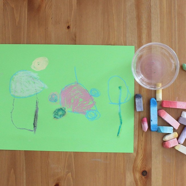 Draw with a chalk on colored paper